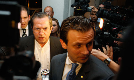 Ecuador's Foreign Minister Patino talks to reporters before a function at a hotel in Singapore