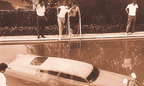 A submerged car which its drunken owner 'parked' in a swimming pool in Beverly Hills