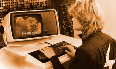 Woman at an old scomputer adding subtitles to a video.