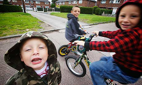 Road safety and poorer areas. Children play on the road in Northern Moor in south Manchester