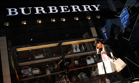 A woman walks past a Burberry Group Plc store in Beijing, China