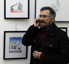 Syrian cartoonist Ali Ferzat at his art gallery in Damascus in December 2010