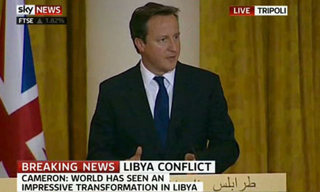 Prime Minister David Cameron makes a speech at a press conference in Libya