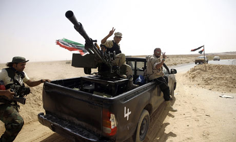 NTC fighters head to the frontline in the city of Bani Walid, Libya where fierce fighting raged