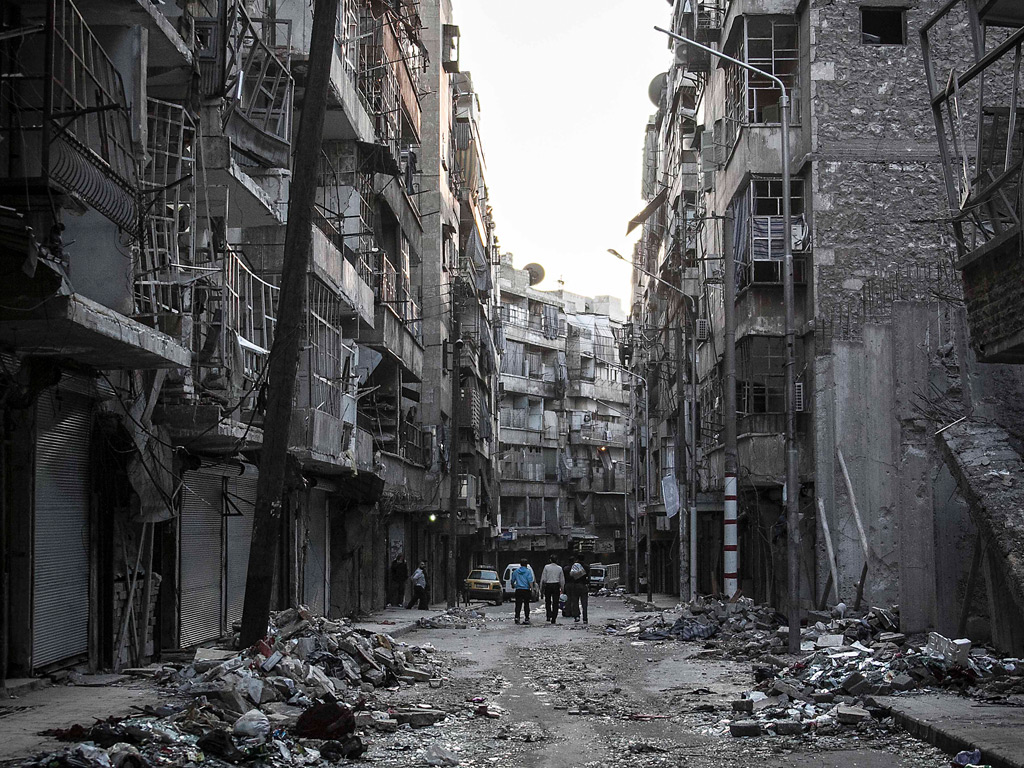 A ruined street in Aleppo after heavy shelling. At least ...