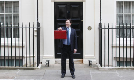 Chancellor of the Exchequer George Osborne holds up his red Ministerial Box at 11 Downing Street