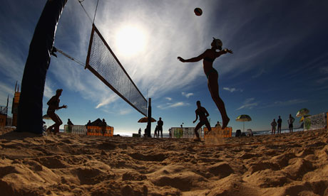 A player spikes the ball during the National Beach Volleyball Series at Manly Beach, Australia
