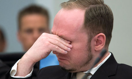 Anders Behring Breivik reacts as a video presented by the prosecution is shown in court