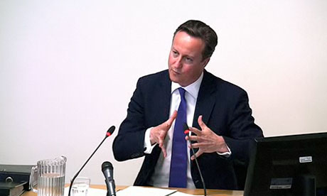 Prime Minister David Cameron gives evidence at the Leveson Inquiry at the High Court