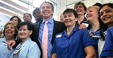 Tony Blair with hospital staff at the opening of Edgware Community hospital in Middlesex