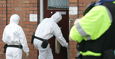 A forensic team enter a house on Ilminster Avenue in Bristol where Barry Wilson was stabbed to death