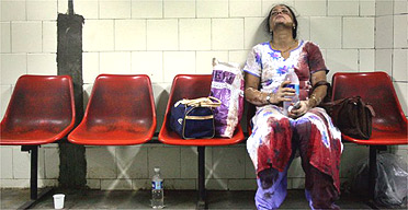 A survivor of the bombing at Matunga railway station waits for treatment in hospital in Mumbai