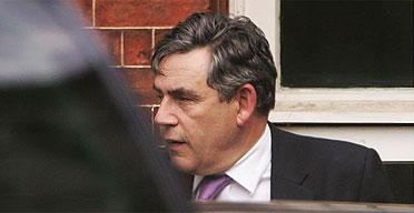 Chancellor of the Exchequer Gordon Brown leaving the back entrance of Downing Street
