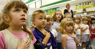 Schoolchildren in Sunderland, Maryland recite the pledge of allegiance. Photograph: Mark Wilson/Getty