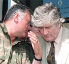 Bosnian Serb Commander Ratko Mladic speaking to Bosnian Serb leader Radovan Karadzic during a meeting in Pale, outside Sarajevo on 5 August 1993. Mdalic has been missing since 2001.