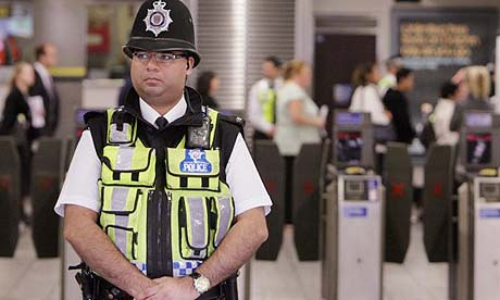 A police officer stands guard at Stockwell tube station during the visit of the jury in the Jean Charles de Menezes inquest