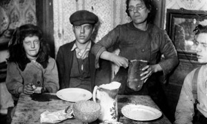 A London family sits down to a meal of bread in 1920