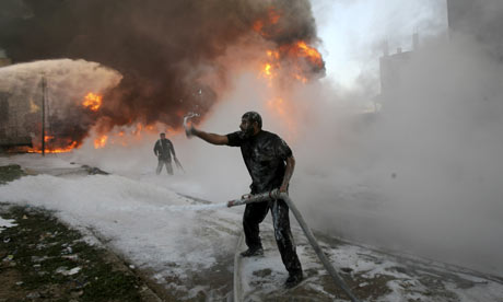 A man fights a fire at a medicine storehouse in the Gaza Strip town of Rafah.