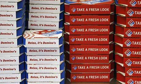 Domino's pizza boxes in a London branch