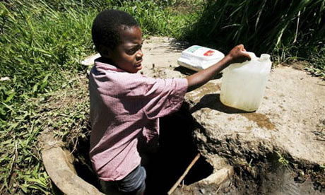 A Zimbabwean child collecting water from a well