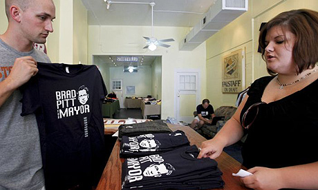 Gabriel Harvey, co-owner of The Storyville Shop in New Orleans listens to customer Stephanie Schneller as she purchases a 'Brad Pitt for mayor' T-shirt.