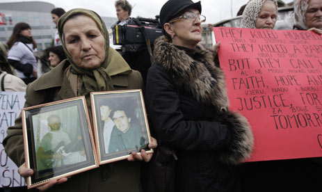 Bosnian women stage a protest in The Hague at the start of the trial against Radovan Karadzic