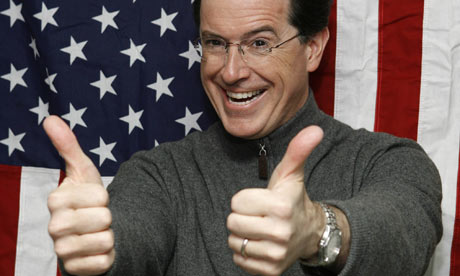 Stephen Colbert sticks his thumbs up