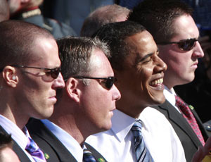 US Secret Service agents escort Barack Obama