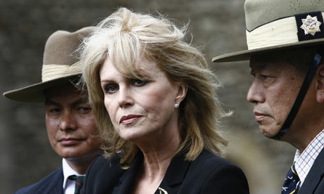 British actress Joanna Lumley with former Gurkha soldiers outside parliament after speaking to MPs