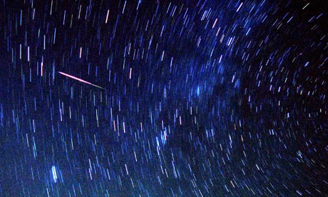 Meteors streak past stars in the night sky near Amman