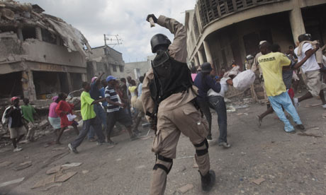 https://static.guim.co.uk/sys-images/Guardian/Pix/pictures/2010/1/17/1263760854587/police-officer-Haiti-002.jpg