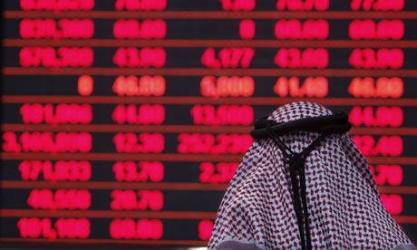 A Qatari investor follows the stock mark