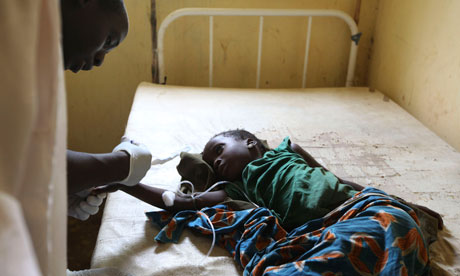 A doctor treats a child suffering from cholera