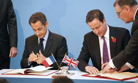 Cameron and Sarkozy signing defence agreement
