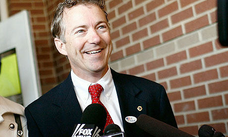 Rand Paul talks to reporters after casting his vote in the 2010 US midterms