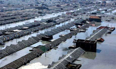 aeriel photo of flooded town in Java