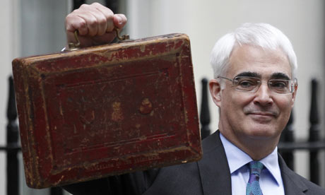 Alistair Darling holds the budget box outside 11 Downing Street on 24 March 2010.