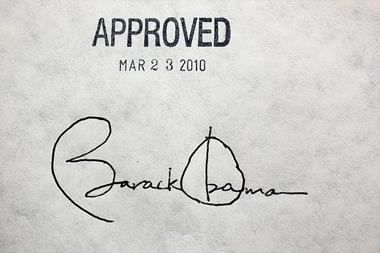 Barack Obama's signature on the healthcare bill