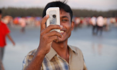 A man uses his mobile phone in Bangladesh