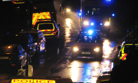 Police car escorts ambulance out of Rothbury