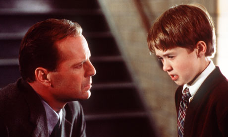 Haley Joel Osment and Bruce Willis in a scene from The Sixth Sense