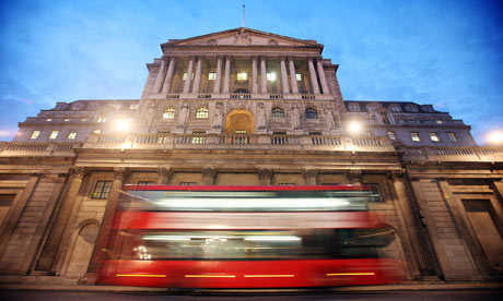 A bus passes the Bank of England in London.