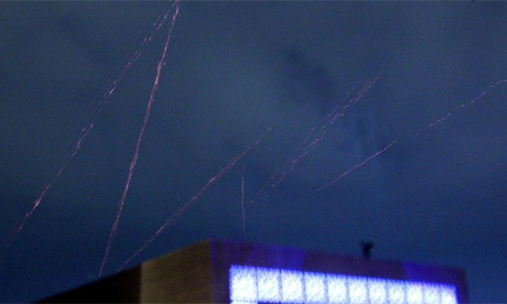 Tracer bullets from anti-aircraft guns streak the night sky over Libya as the US and European attack gets under way