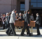 Pallbearers bring in the casket of Christina-Taylor Green at her funeral on 13 January 2011.