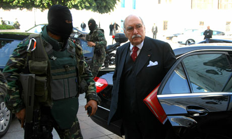 Interim Tunisian President Fouad Mbazaa arrives at the Government palace in Tunis.