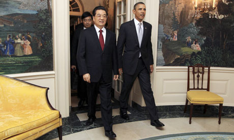 President Hu Jintao arrives at the White House for a private banquet held by President Barack Obama