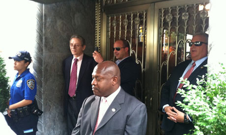 Security outside billionaire David Koch's apartment in New York for Occupy Wall Street protesters