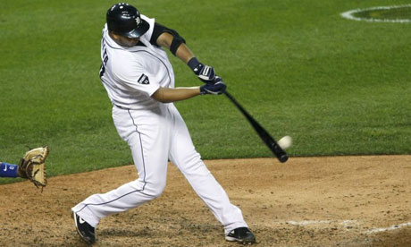 Detroit Tigers' Jhonny Peralta hits a solo home run against the Texas Rangers