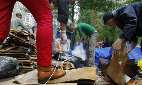 Occupy Wall Street protesters begin a clear-up of Zuccotti Park in New York