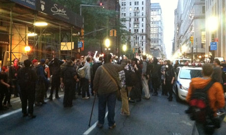 Occupy Wall Street protesters march on Broadway after clean-up is called off
